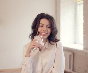 Young woman drinking yogurt