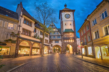 Schwabentor - historical city gate at dusk in Freiburg im Breisgau, Baden-Wurttemberg, Germany