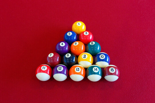 Colorful pool balls on a red table