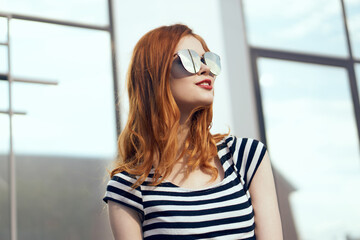 stylish lady with glasses, red lips, room