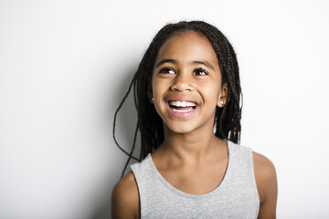 Adorable african little girl on studio gray background