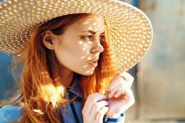 stylish lady in a wide-brimmed straw hat
