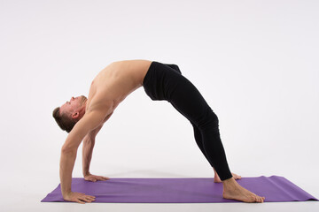 Pose bridge. Fitness and healthy lifestyle.  Sexy man and a healthy lifestyle. Sport and strength.