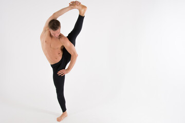 Flexibility. Fitness and healthy lifestyle.  Sexy man and a healthy lifestyle. Sport and strength.