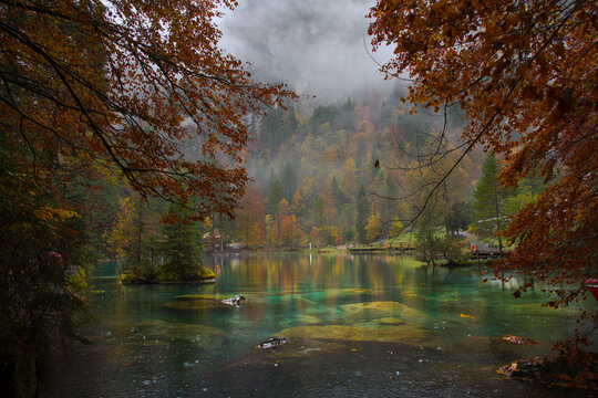 Scenic landscape view of blue lake in Autumn. Crystal clear lake of Blausee Switzerland