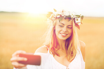 happy young woman taking selfie by smartphone