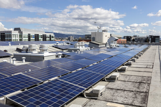 Building rooftop with blue solar panels