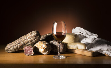salami  cheese and wine on the table