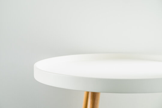 Empty modern round white table top at white house wall,Mock up space for display or montage of product