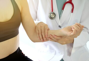 Doctor and patient, Examination of the arm and elbow, Sport exercise injuries. (Selective Focus)
