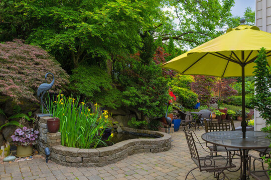 House Backyard Hardscape with Garden Patio Furniture spring season