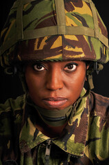 Portrait of female soldier wearing British military uniform.
