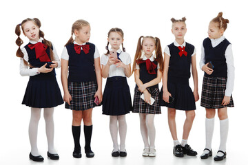 a group of school-aged children in the form of phones isolated on a white background