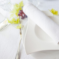Table setting for lunch or dinner with guests,white tones