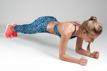 Sport woman doing a plank exercise