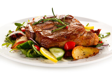 Grilled chicken fillet with vegetables on white background