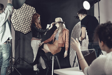 Fashion stylist with model at photoshoot Wall mural