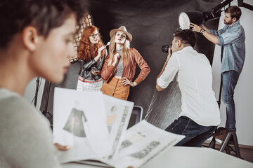 Make up artist preparing model