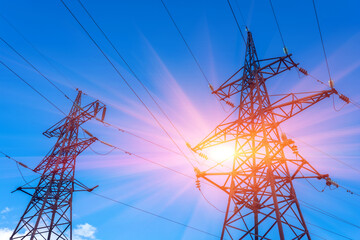 High-voltage lines against the blue sky at sunset.