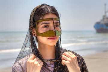 Portrait of an Iranian girl in traditional dress southern Iran.