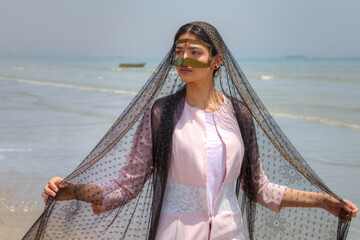 Young muslim woman wears gold mask, Hormozgan province, southern Iran.
