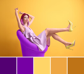 Color matching palette. Young woman with dyed lilac hair sitting in armchair on orange background