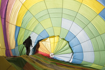 Man Standing In Colorful Hot Air Balloon