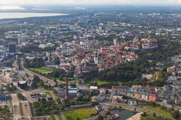 Scenic summer aerial shot of the very Old Town with old park in Tallinn, Estonia