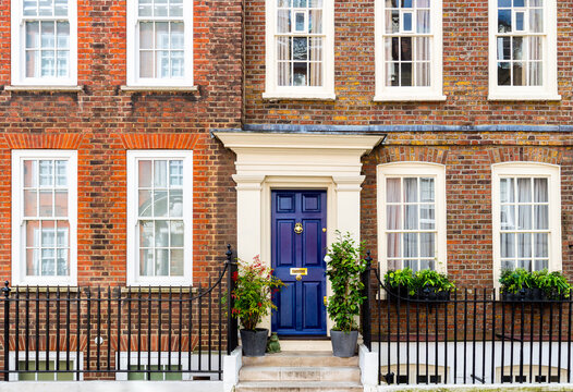 The facade to a traditional town house typical to the district of central London