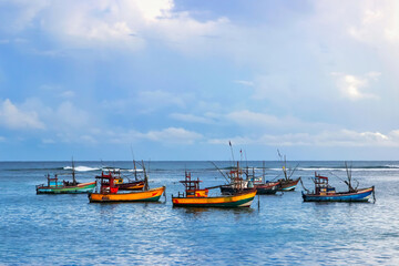 Fishermen colored boats on the water. Indian Ocean. Sri Lanka.
