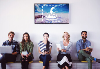 Smiling Employees Seated in Front of TV Mockup