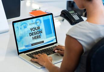 Laptop User Seated at Desk Mockup