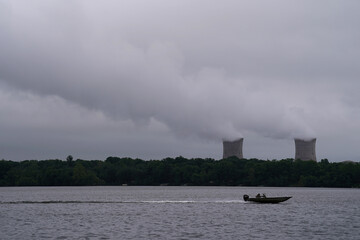 A boat navigates the Susquehanna River in front of the Three Mile Island Nuclear power plant in Goldsboro