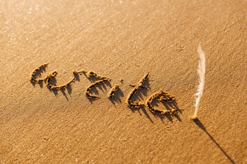The inscription on the sand. Write concept.