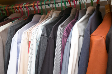 men simple clothing in the wardrobe of the many kind and colored clothes
