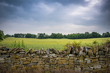 Stone Wall with Farmland Landscape