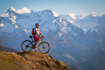 Male mountainbiker enjoying the view in the mountains Wall mural