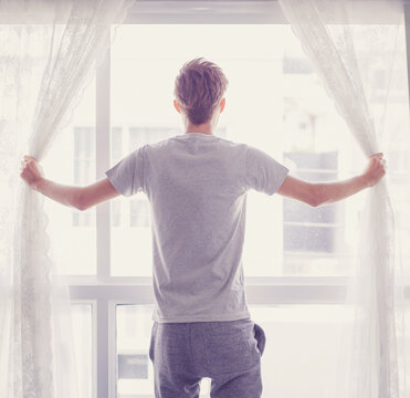 man and hope concept - man opening window curtains business concept.