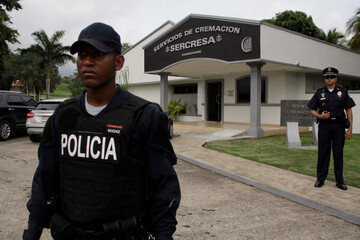 Police officers guard the entrance to Cremation Service House after 83-year-old former Panamanian dictator Manuel Noriega died, in Panama City,