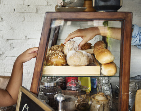 Customer is selecting the order at bake shop