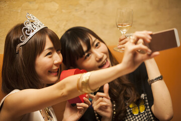 Women are taking self-shots with gifts