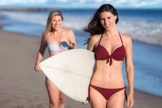 Gorgeous beautiful female friends portrait on holiday trip spend summer day surfing having fun