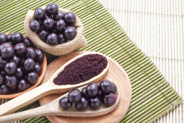 Fruits and acai powder originating from the Amazon  (Euterpe oleracea)