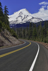 Snow covered Mount Hood, a volcano in the Cascade Mountains in Oregon popular for hiking, climbing, snowboarding and skiing, despite the risks of avalanche, crevasses and volatile weather on the peak.
