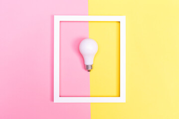 Colored lightbulb on a duotone background
