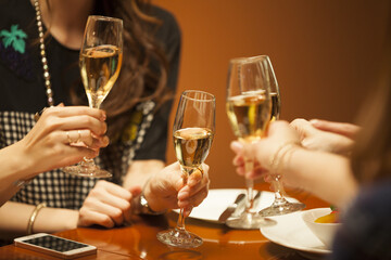 Four women are drinking in a luxurious restaurant with champagne