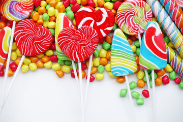 sweets and sugar candies colorful, handmade swirl lollipop for background