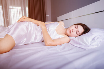 Woman sleeping on bed with soft light