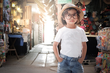 Asian girl wearing white t-shirt. Denim shorts Sunglasses and hats Pose Fashion