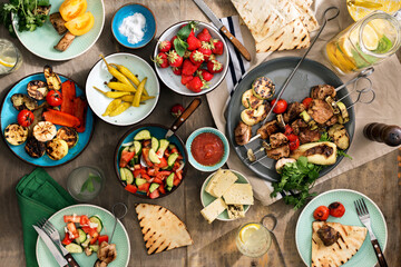 Shish kebab, various grilled vegetables, salad, lemonade, strawberries and snacks